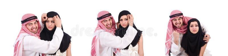 Арабский человек с его женой на белизне стоковое изображение
