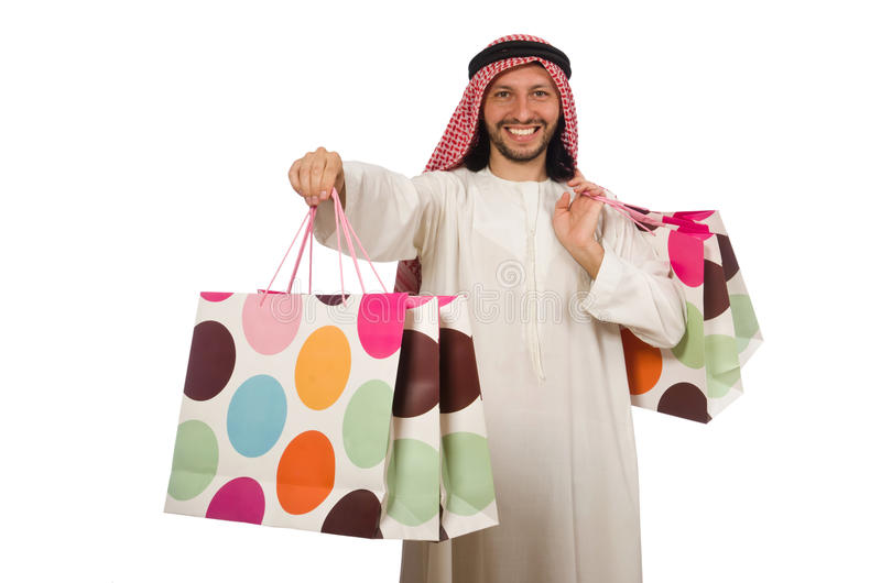 Арабский человек с хозяйственными сумками на белизне стоковое изображение rf