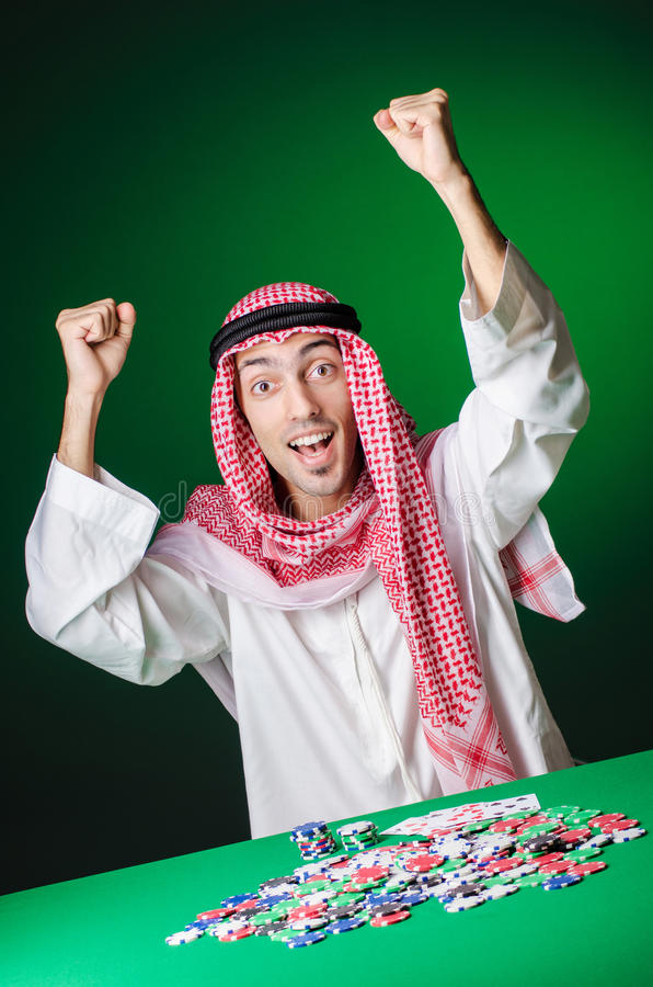 Араб играя в казино Стоковое Изображение