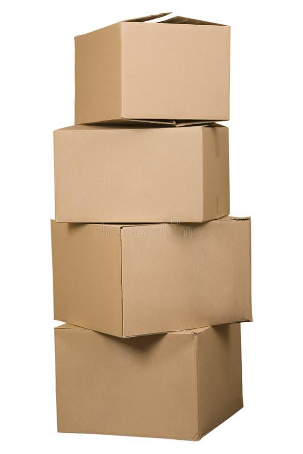 аранжированный стог картона коробок коричневый стоковое фото rf