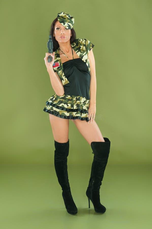 армия одевает сексуальную женщину стоковое фото rf