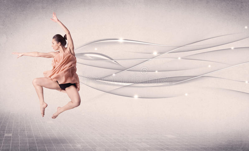 Артист балета выполняя современный танец с абстрактными линиями стоковое фото