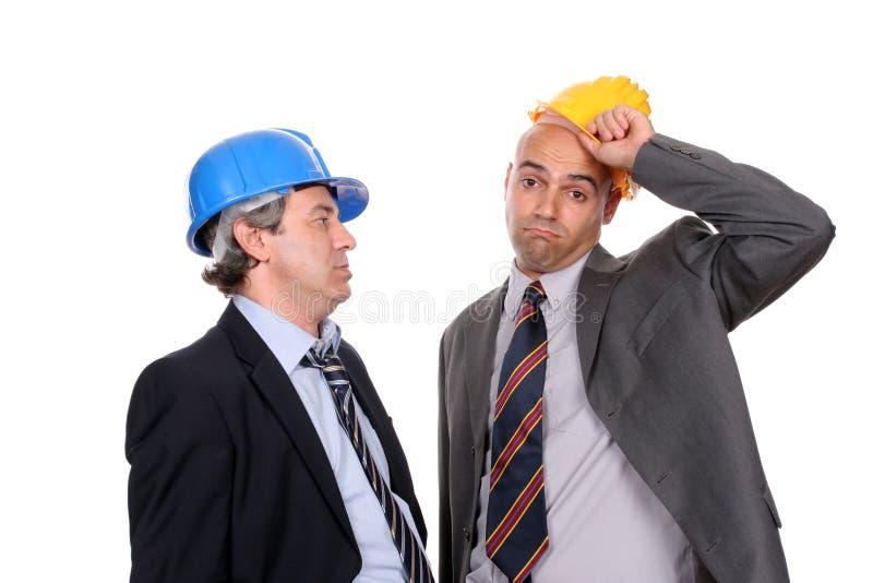 архитекторы обсуждая проект 2 инженеров новый стоковое фото rf