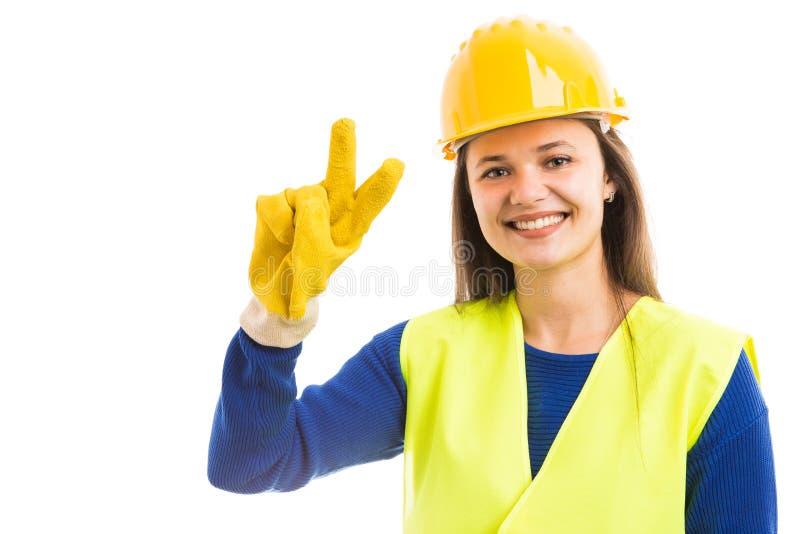 Архитектор молодой женщины показывая знак мира стоковые изображения rf