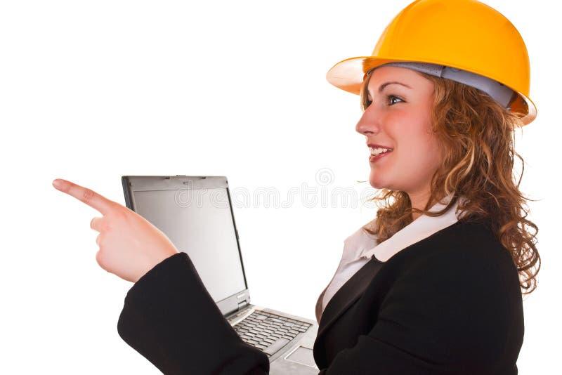 архитектор налево указывая женщина стоковая фотография