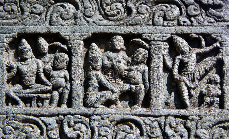 Архитектурноакустические детали каменного резного изображения в старом индусском виске стоковые фото