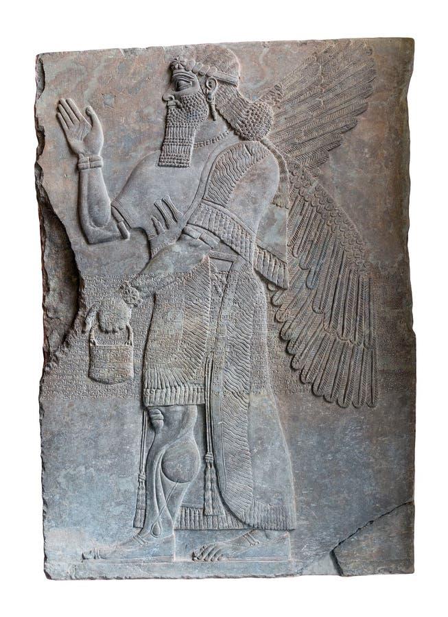Ассирийское искусство на стене, король Ashurnasirpal II стоковое изображение rf