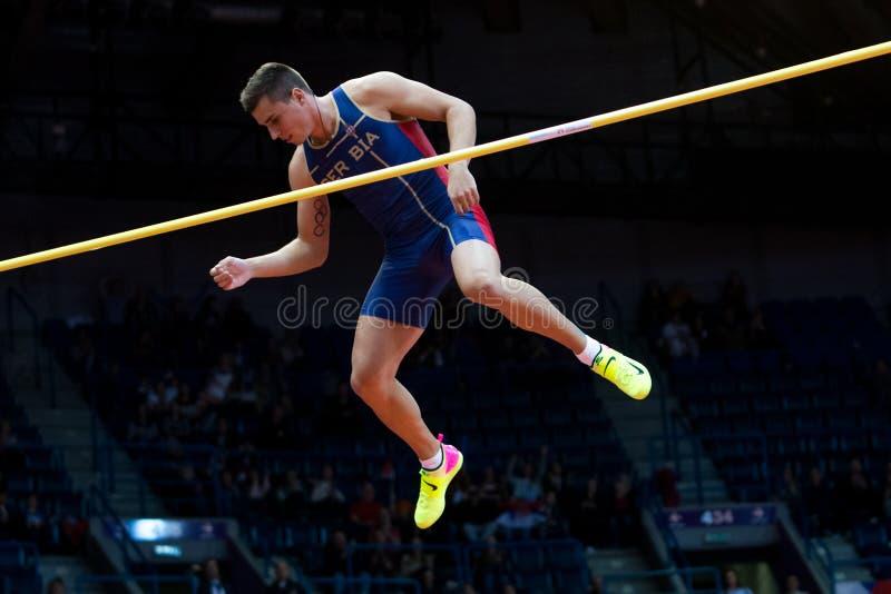 Атлетика - Mihail Dudas; Семиборье человека, прыжок с шестом стоковая фотография rf