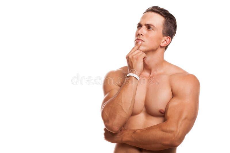 Атлетический мышечный спортсмен на изолированной студии стоковые изображения