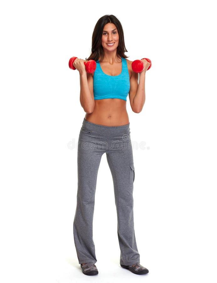 атлетическая девушка гантелей стоковые изображения