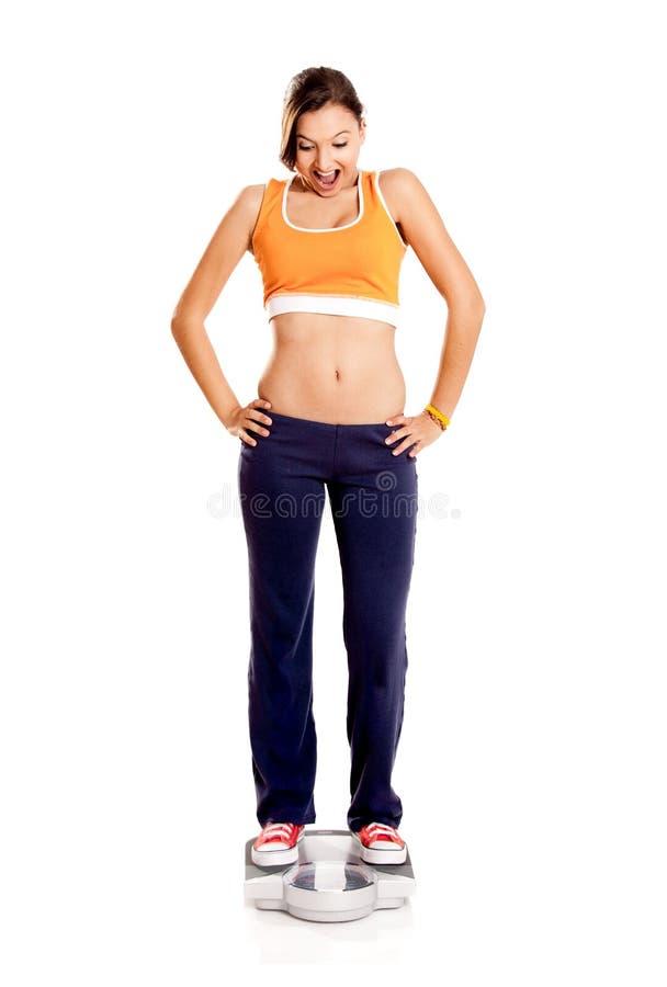 атлетическая девушка счастливая стоковое фото rf