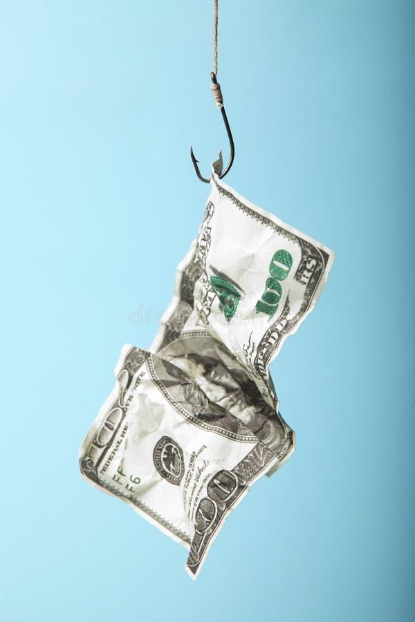 Афера денег, прикорм 100 долларов стоковая фотография rf