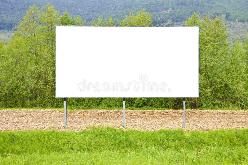 Афиша погруженная в сельской сцене - изображение пробела коммерчески рекламируя с космосом экземпляра стоковое изображение rf