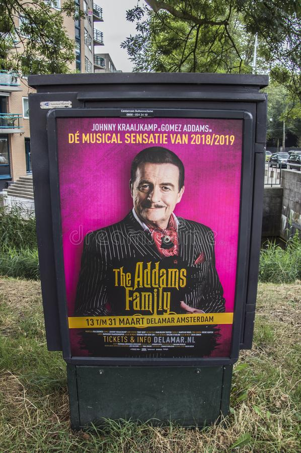 Афиша Centercom семья Addams на нидерландское 2018 стоковые фото