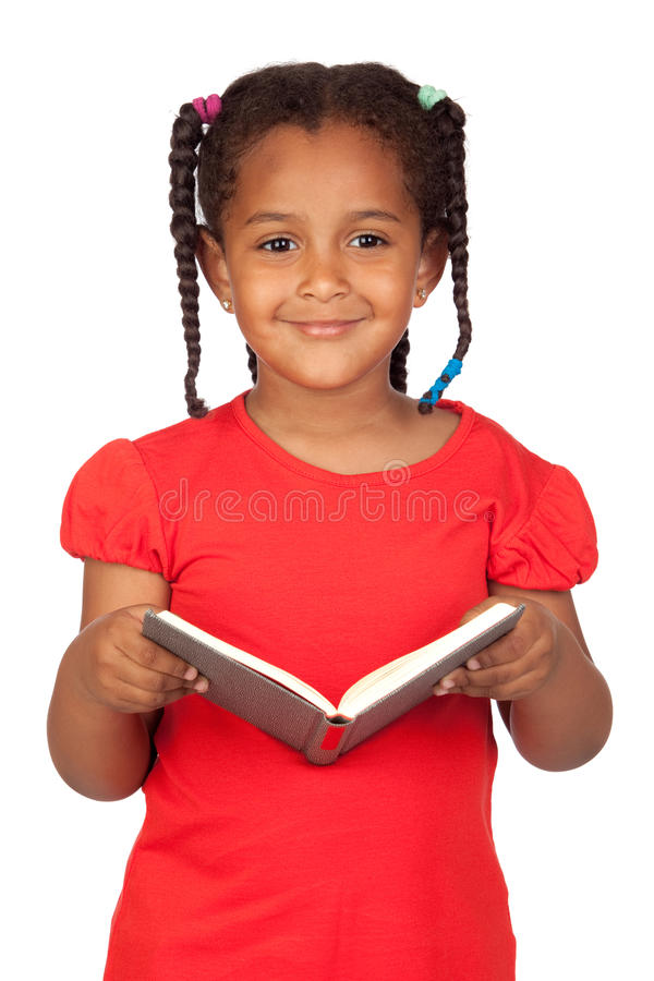 африканская девушка книги меньшее чтение стоковая фотография