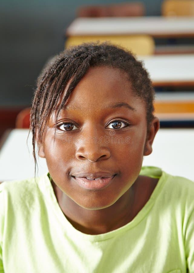 Африканская девушка в классе стоковая фотография rf