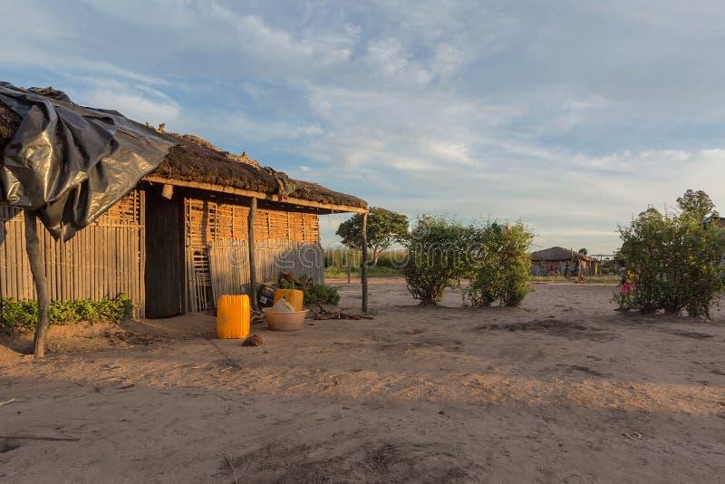 Африканская деревня с заходом солнца стоковые фотографии rf