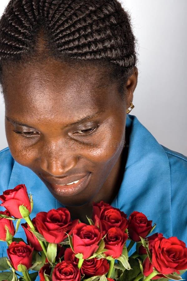 африканская женщина роз стоковые изображения rf