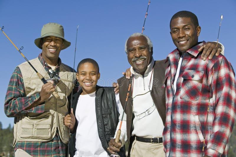Африканская семья с рыболовными удочками стоковое изображение rf