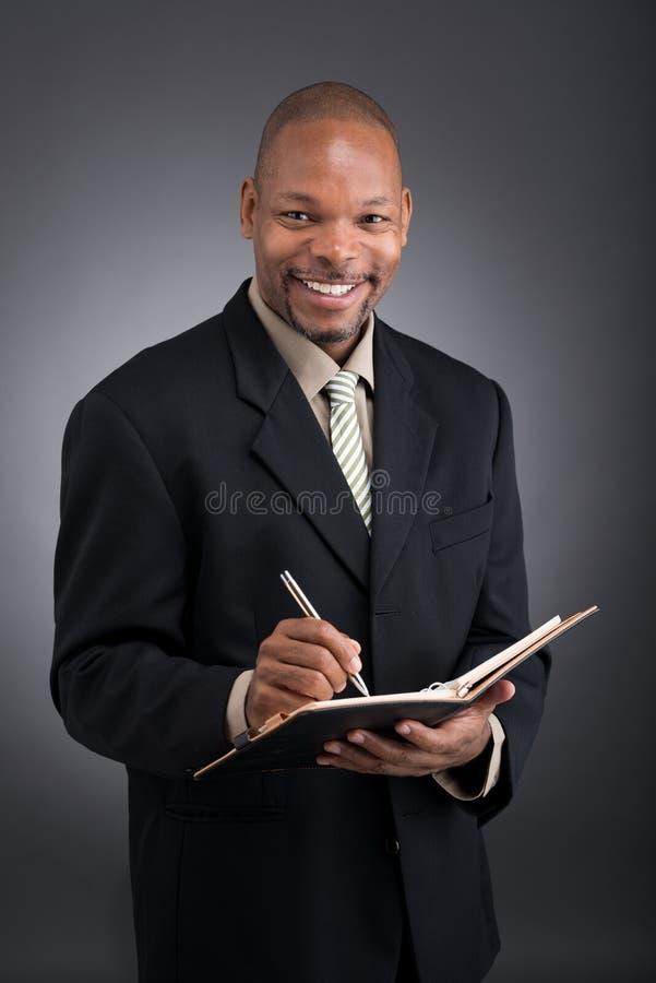 Download Африканский бизнесмен стоковое изображение. изображение насчитывающей корпоративно - 33739633