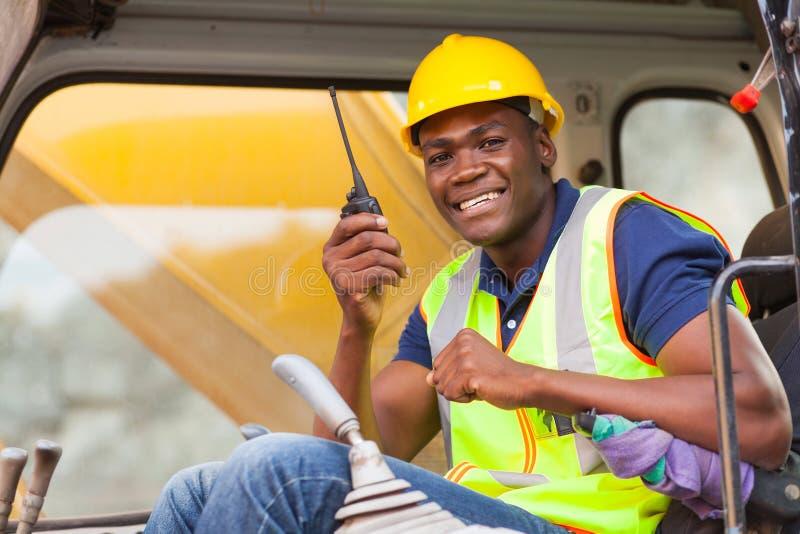 Африканский оператор бульдозера стоковая фотография