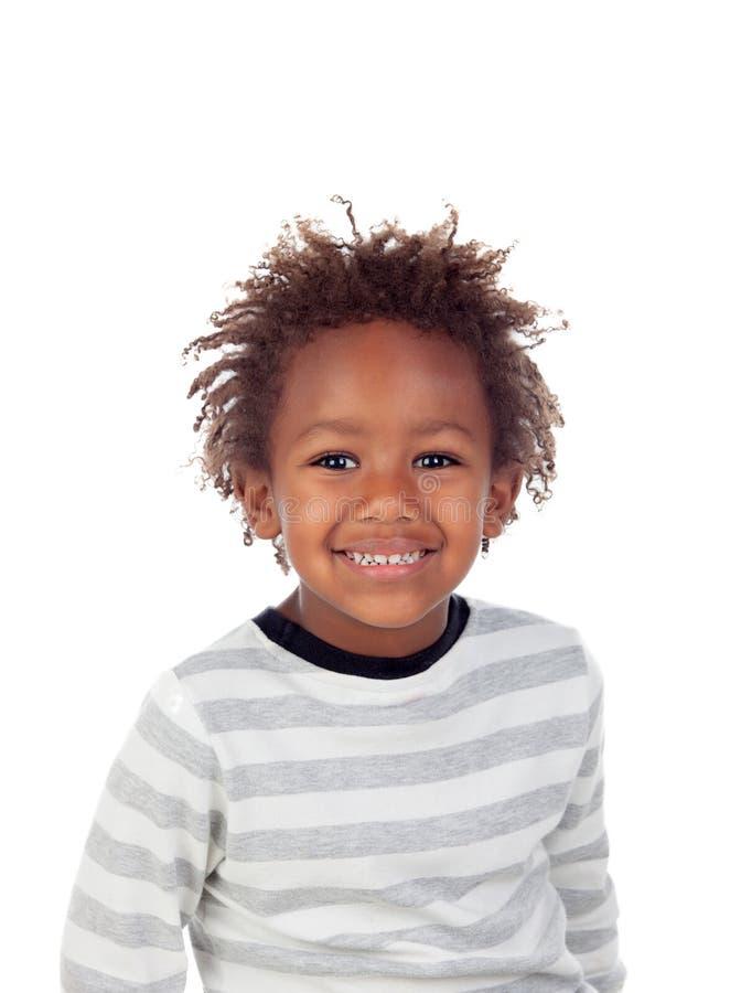 Африканский ребенок делая смешные стороны стоковые фото