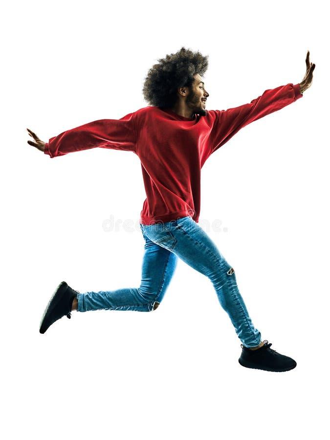 Африканский человек скача счастливый изолированный силуэт стоковые фотографии rf