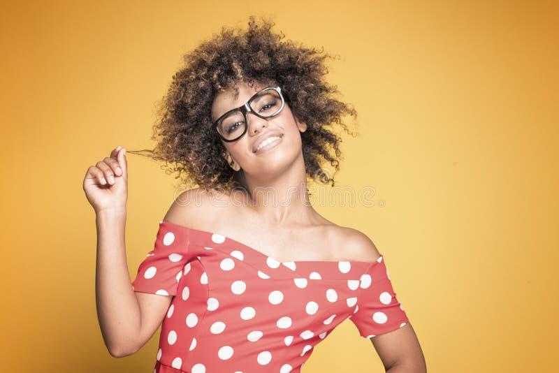 Афро-американская девушка в красном платье стоковая фотография rf