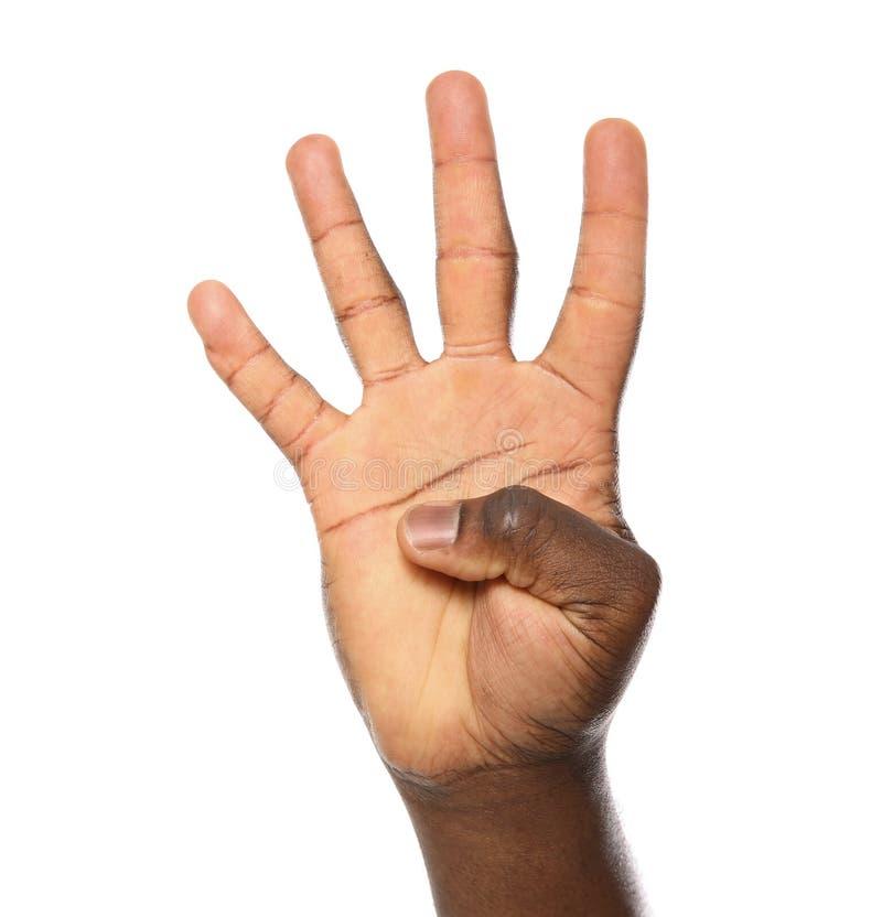 Афро-американский показ 4 человека на белой предпосылке стоковые фото