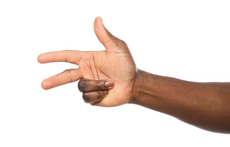 Афро-американский человек показывая номер два на белой предпосылке стоковое фото rf