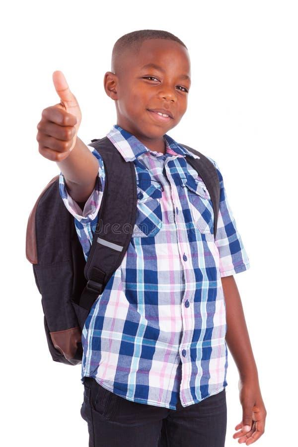 Афро-американский школьник делая чернокожие люди больших пальцев руки вверх - стоковое фото rf