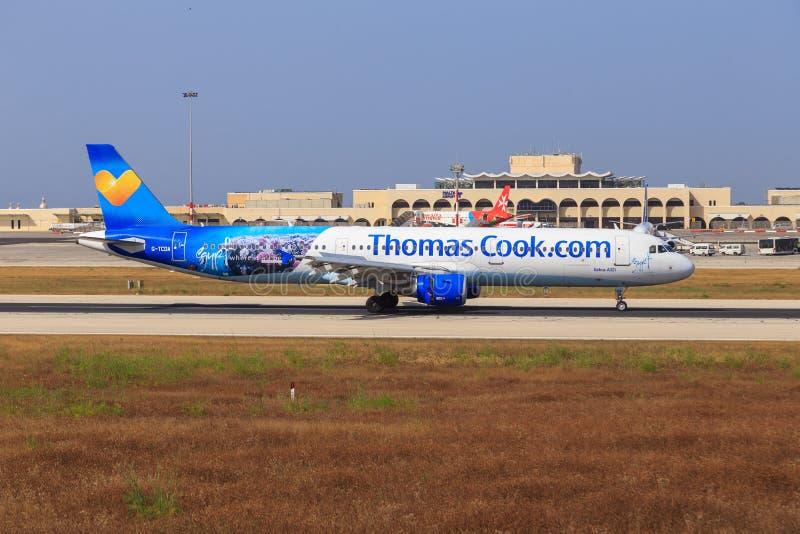 Аэробус A321 кашевара Томаса на Мальте стоковая фотография