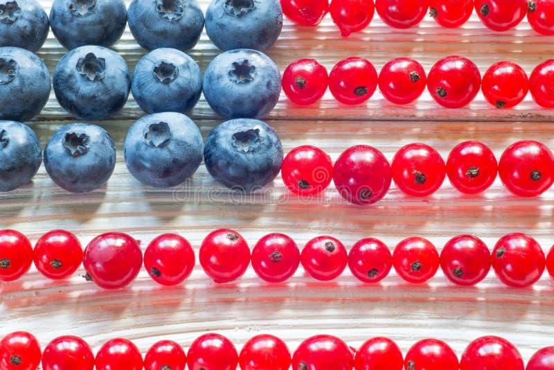 4-ая из ягоды концепции в июле с американским флагом стоковая фотография rf