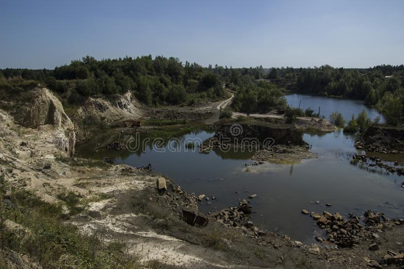 Базальт для строить Карьера базальта Штендеры базальта Каменная раскопк Тяжелая индустрия стоковое изображение