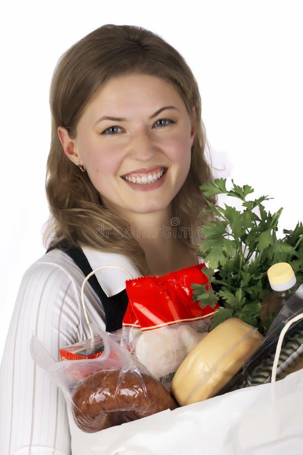 бакалеи мешка держа женщину стоковое изображение
