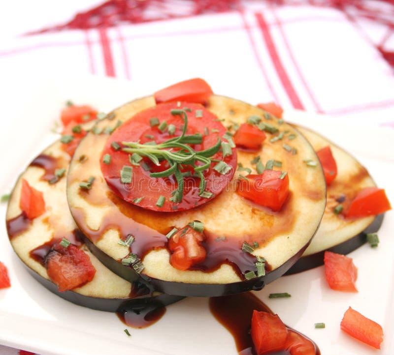 Баклажаны и томаты стоковое фото