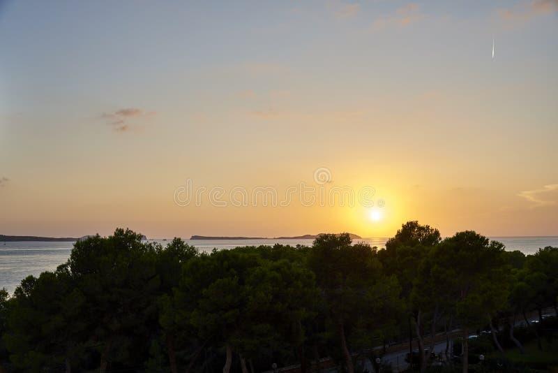 Балеарский заход солнца от Ла Savina в Форментере с Es Vedra Ibiza в предпосылке стоковая фотография rf