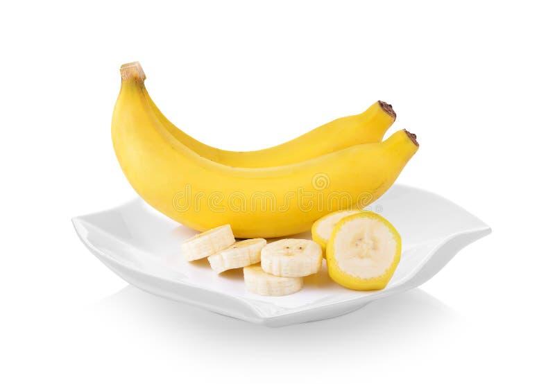 Бананы в форме плиты красивой на белой предпосылке стоковое фото