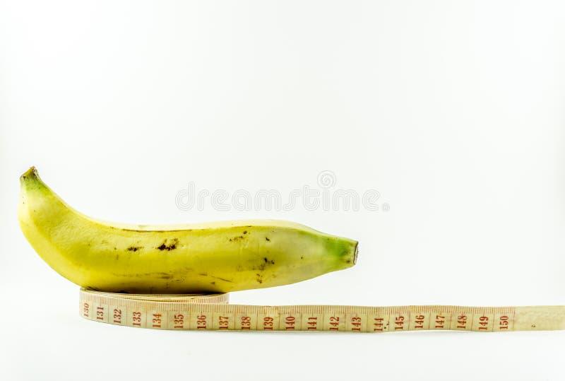 Банан и измеряя лента стоковые изображения