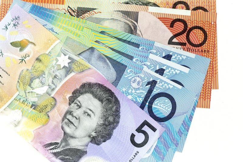Банкноты валюты распространили через доллар рамки австралийский в различной деноминации стоковые фото