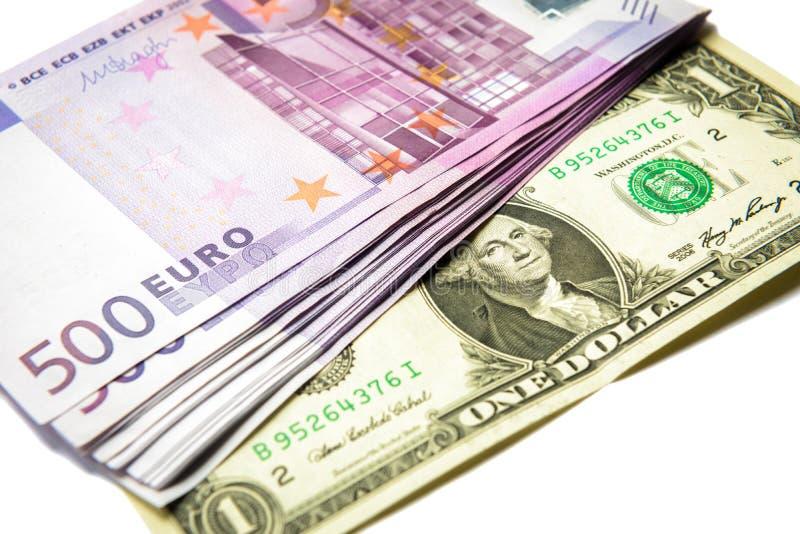 500 банкнот денег евро против 1 доллара стоковые изображения
