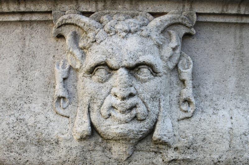 Барельеф маски сатира стоковые фотографии rf