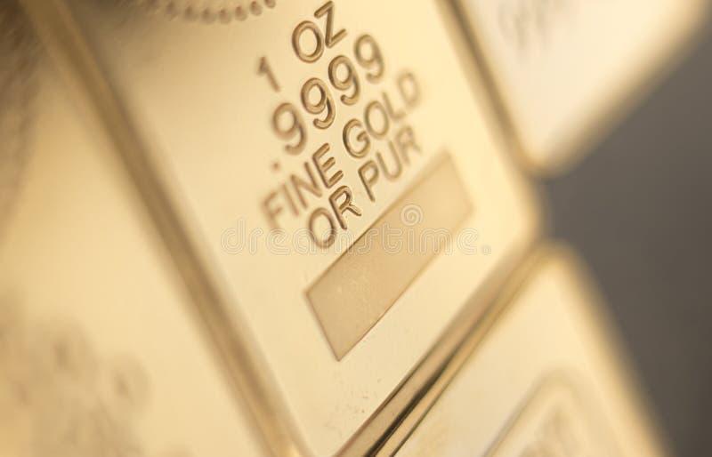 Бар слитка миллиарда золота стоковые изображения