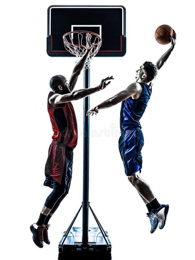 Баскетболисты укомплектовывают личным составом скача dunking силуэт стоковое изображение rf