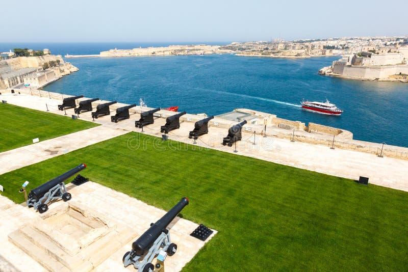 Батарея и грандиозная гавань Валлетты стоковое фото rf