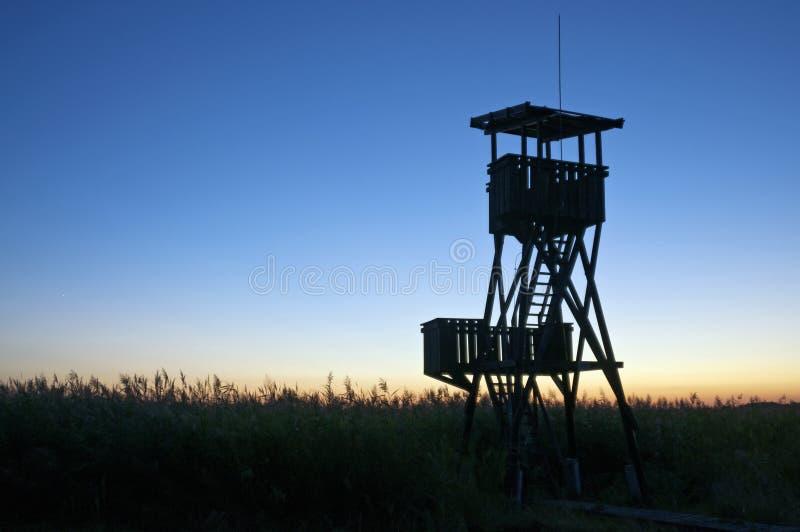 Башня бдительности на заходе солнца стоковые фото