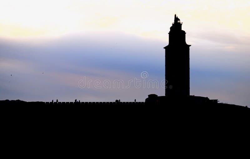 Башня Геркулеса против света стоковые фото