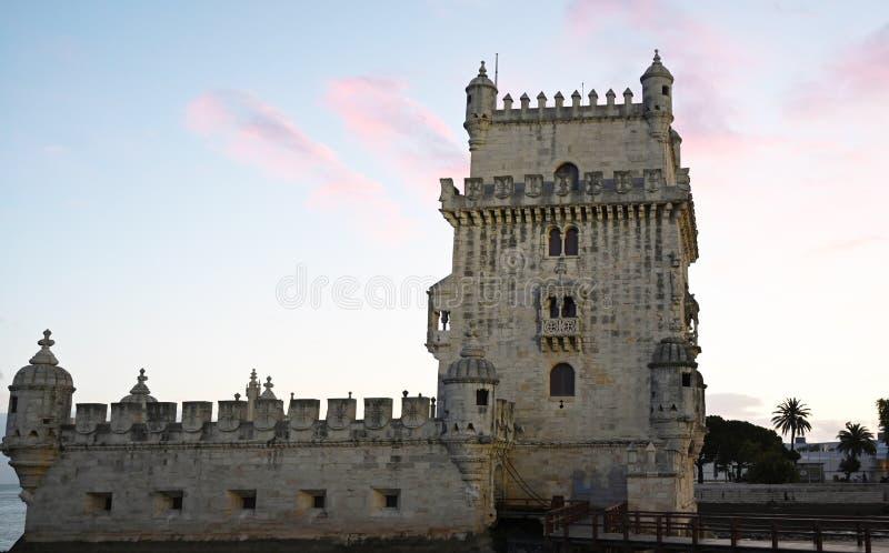 Башня Belem в Лиссабоне на заходе солнца стоковое фото rf
