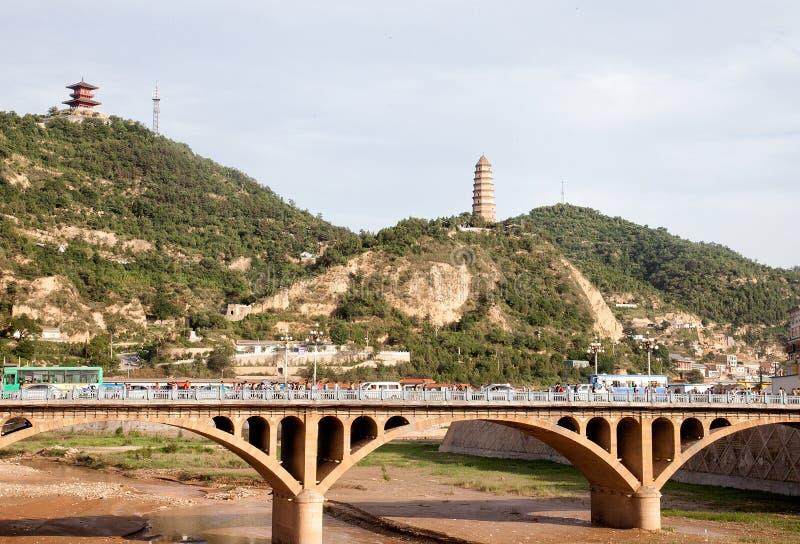 Башня Yanan и мост радуги стоковые фотографии rf