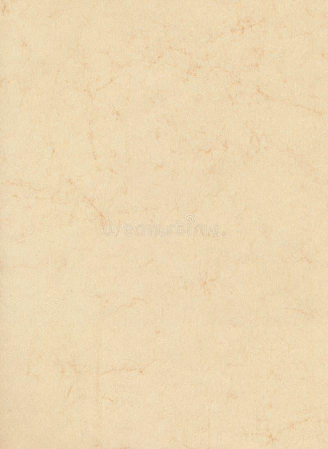 Бежевая мраморизованная бумага стоковая фотография
